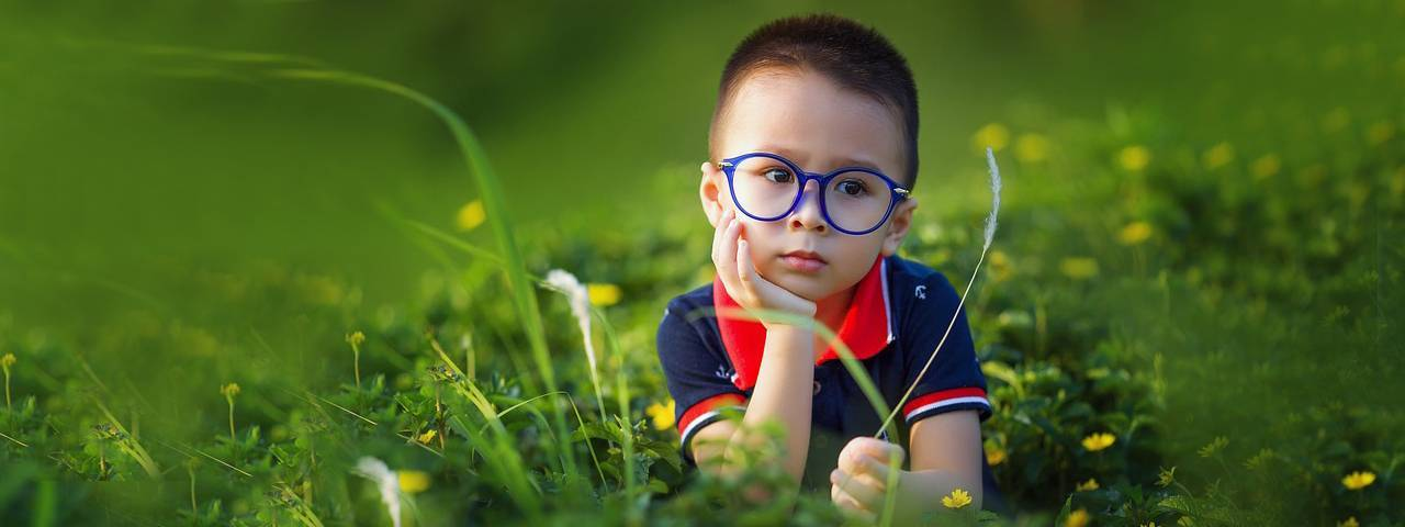 optometrist, liitle boy thinking his vision problems in West Hartford, Connecticut